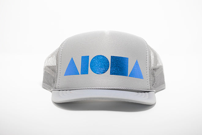 Youth foam trucker hat. Light grey foil printed with metallic blue Aloha Shapes ® logo