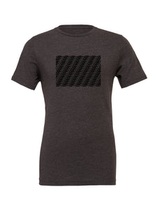 Grey t-shirt printed with a repeating pattern of Aloha Shapes ® logos that form stripes in pattern