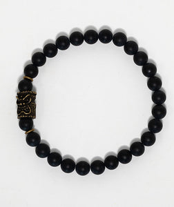 Black agate bead bracelet with bronze tiki charm handmade in Maui, Hawaii
