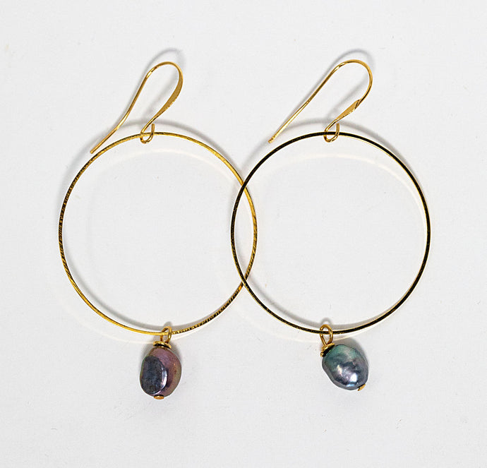 Freshwater pearls dangle from gold plated hoop earrings handmade in Maui, Hawaii