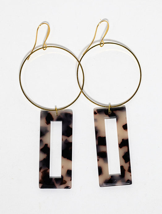 Faux tortoise shell resin rectangle shaped charms hanging form gold plated hoops. Earrings handmade in Maui, Hawaii
