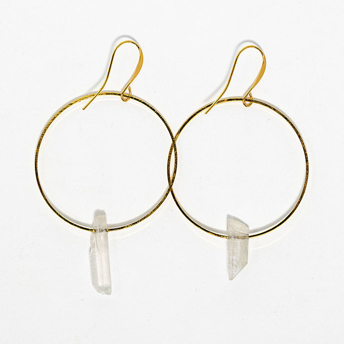 Clear quartz crystal points on gold plated hoops. Earrings handmade in Maui, Hawaii