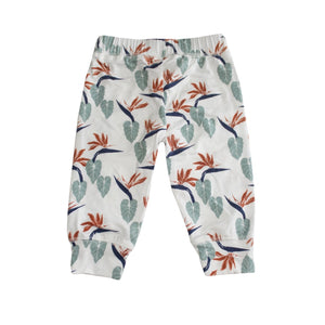 White baby leggings with tropical bird of paradise print. Designed in Hawaii. Made in Bali