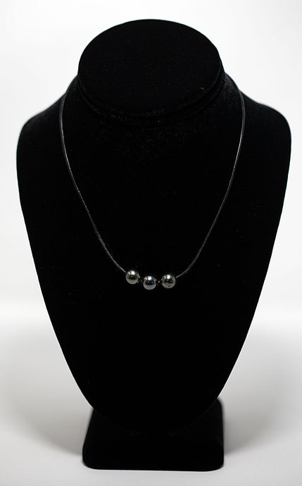Three tahitian pearls strung on black leather necklace handmade in Maui, Hawaii