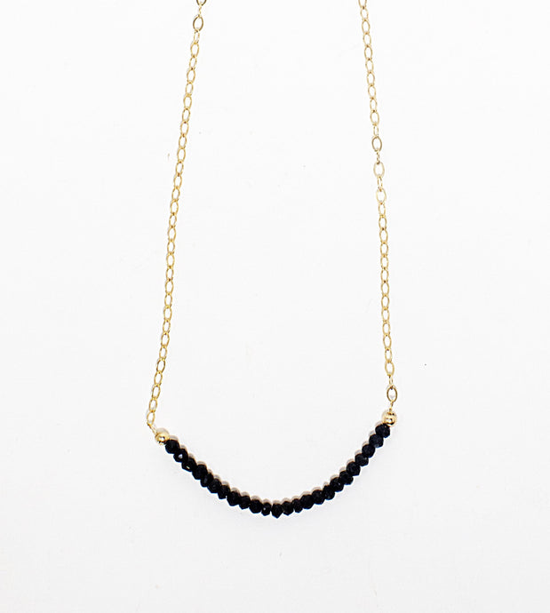 Black spinel gemstone choker on 14 karat gold fill chain. Handmade in Maui, Hawaii