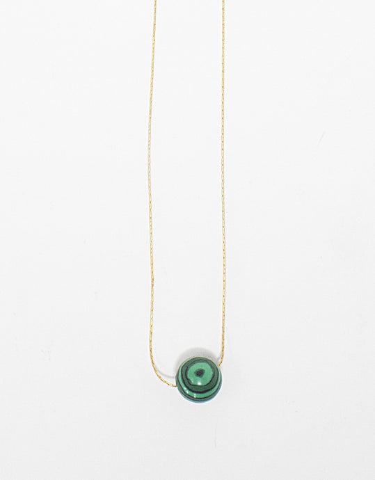 Malachite gemstone solitaire on 14 karat gold fill chain. Handmade in Maui, Hawaii