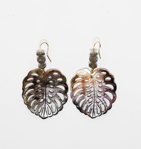 Monstera leaf shaped earrings carved from abalone shell with labradorite gemstones. Handmade in Maui, Hawaii