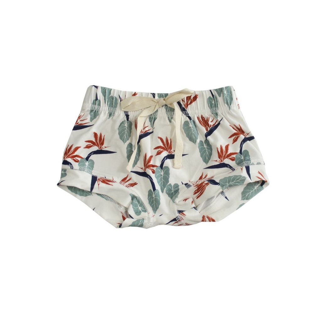 White bamboo fabric toddler shorts printed with white tropical bird of paradise. Designed in Hawaii. Made in Bali