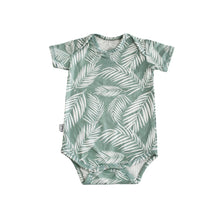 Jade green baby onesie with white tropical palm fronds. Designed in Maui. Made in Bali