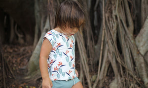 Young child wearing tropical toddler clothes designed in Maui, HI by Skye HI