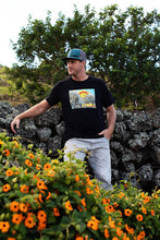 Man wearing t-shirt of Cartoon drawing of west side Maui beach surf spot designed in Big Island Hawaii and printed in Maui, Hawaii