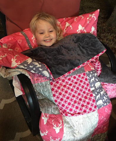 Pink and gray antler quilt