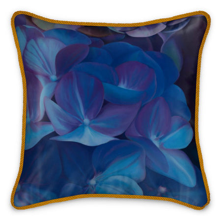 "Transform your interior space into a live-in art gallery with this work of art crystallizes in a beautiful floral silk cushion that features the vibrant ""Sapphire Blue Hydrangea"" design by renowned Canadian artist/designer Carling Wong-Renger."