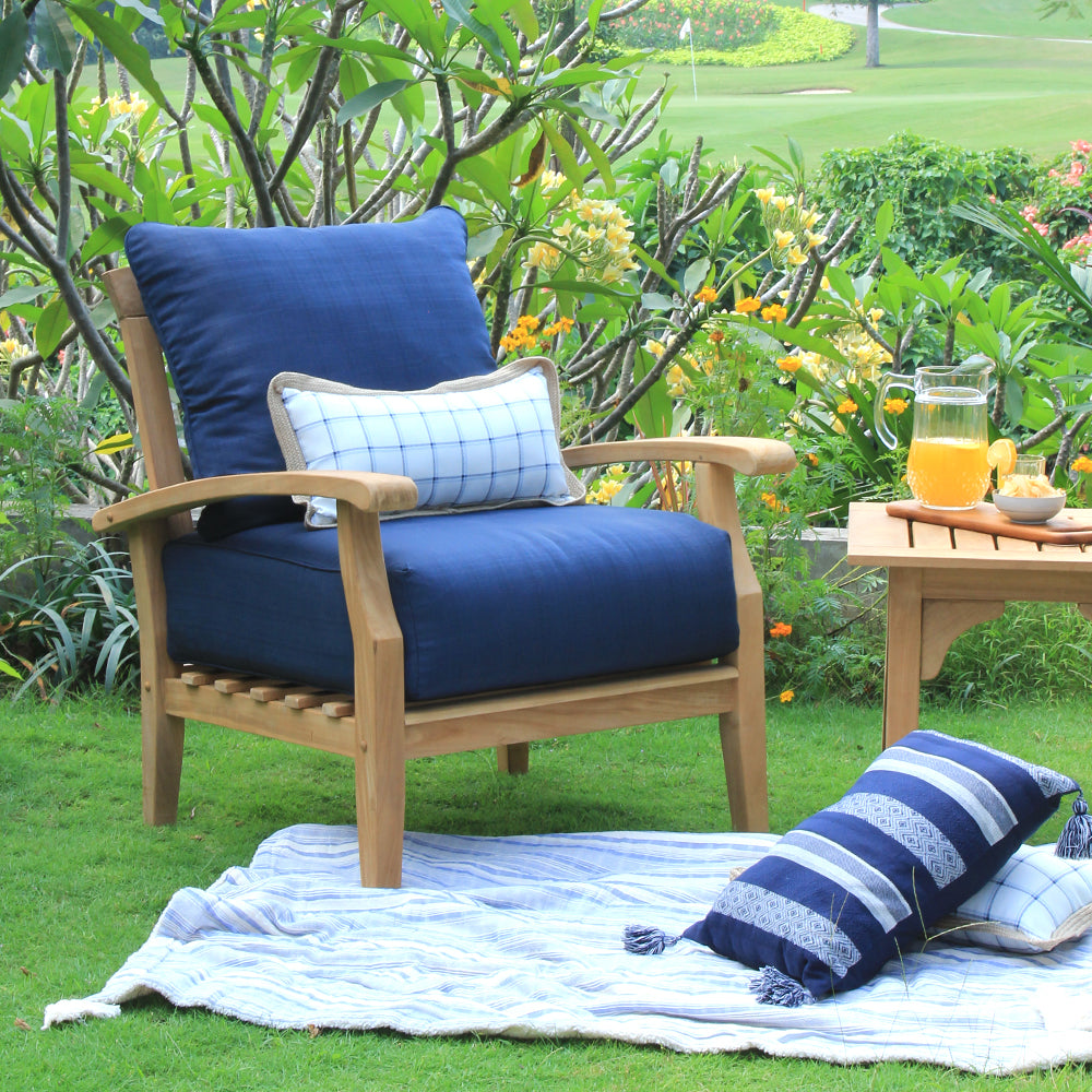 Buy these beautiful Caterina Solid Teak Wood Outdoor Lounge Chair with Navy Cushion from Cambridge Casual today. Their comfort and style make them the perfect furniture for any patio.