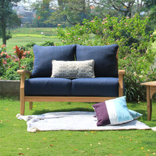 Purchase a Caterina Solid Teak Wood Outdoor Loveseat with Navy Cushion from Cambridge Casual to complete your outdoor furniture collection!