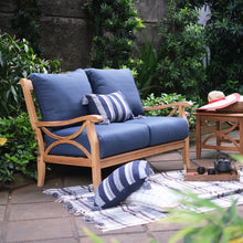 Style up your garden to its full potential with Abbington Solid Teak Wood Outdoor Loveseat with Navy Cushion from Cambridge Casual.