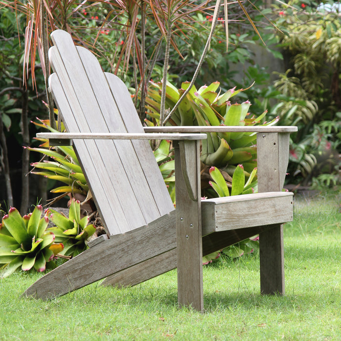 Own this good-looking Richmond Weathered Teak Wood Adirondack Chair today from Cambridge Casual. Its versatile design will complete your garden seating arrangement.
