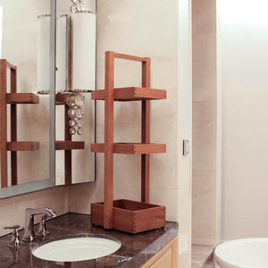 This versatile Dussi Solid Teak Wood Shower Caddy from Cambridge Casual. It has a simple and modern design that suits any number of bathroom styles.