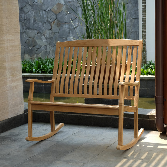 Relax and unwind in the Richmond Solid Teak Wood Outdoor Loveseat Rocker from Cambridge Casual. It's the perfect piece of outdoor furniture for those long summer nights.