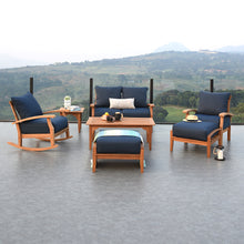 Complete your patio furniture arrangement with this splendid Caterina Solid Teak Wood Outdoor Ottoman with Navy Cushion, available now from Cambridge Casual.