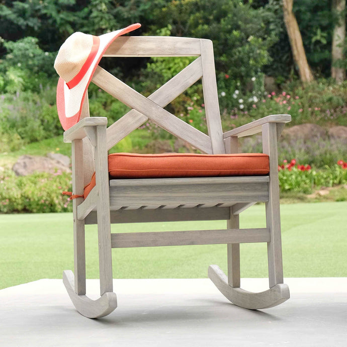 Buy this Carlota Solid Wood Outdoor Rocking Chair with Brick Cushion as it is the perfect furniture to your porch or backyard. It will style up and comfort to your life. Available at Cambridge Casual today!
