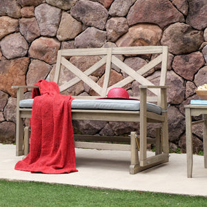 This Carlota Solid Wood Outdoor Glider Bench with Blue Spruce Cushion is the perfect addition to your front porch or backyard. It will add up style and comfort to your life. Purchase it from Cambridge Casual today.