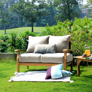 Purchase a Caterina Solid Teak Wood Outdoor Loveseat with Beige Cushion from Cambridge Casual to complete your outdoor furniture collection!