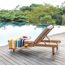 Get your poolside furniture Mosko teak chaise lounge with beige cushion from Cambridge Casual patio furniture!