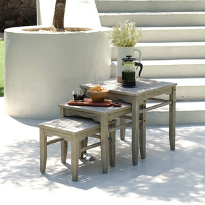 Buy this Carlota Solid Wood Weathered Gray Outdoor Nesting Side Table to be the perfect addition to your patio seating arrangement. Buy them today from Cambridge Casual.