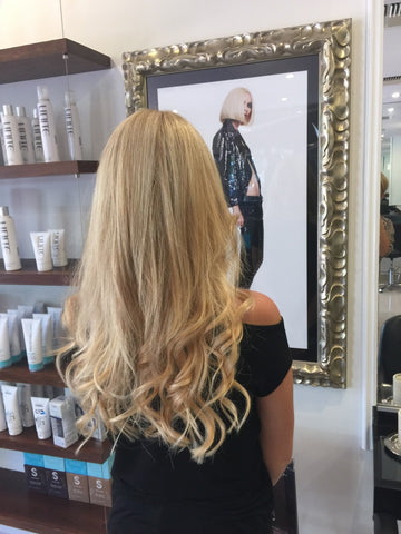 woman hairstyle colour showpony tape hair extensions blonde and L'oreal highlights
