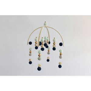 Navy and pebbles felt ball mobile