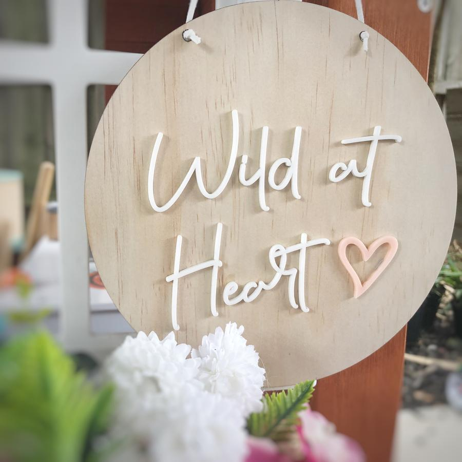 'Wild at heart' round wall hanging