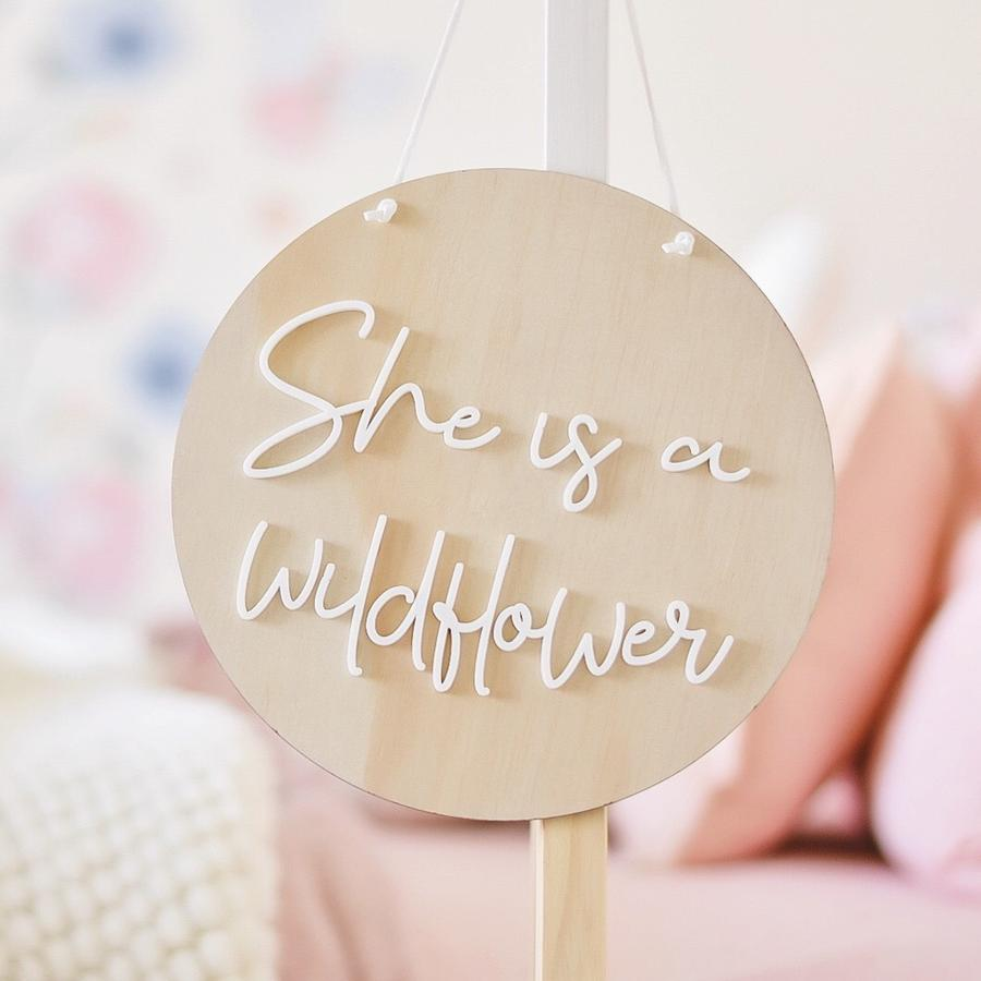 'She is a wildflower' round wall hanging