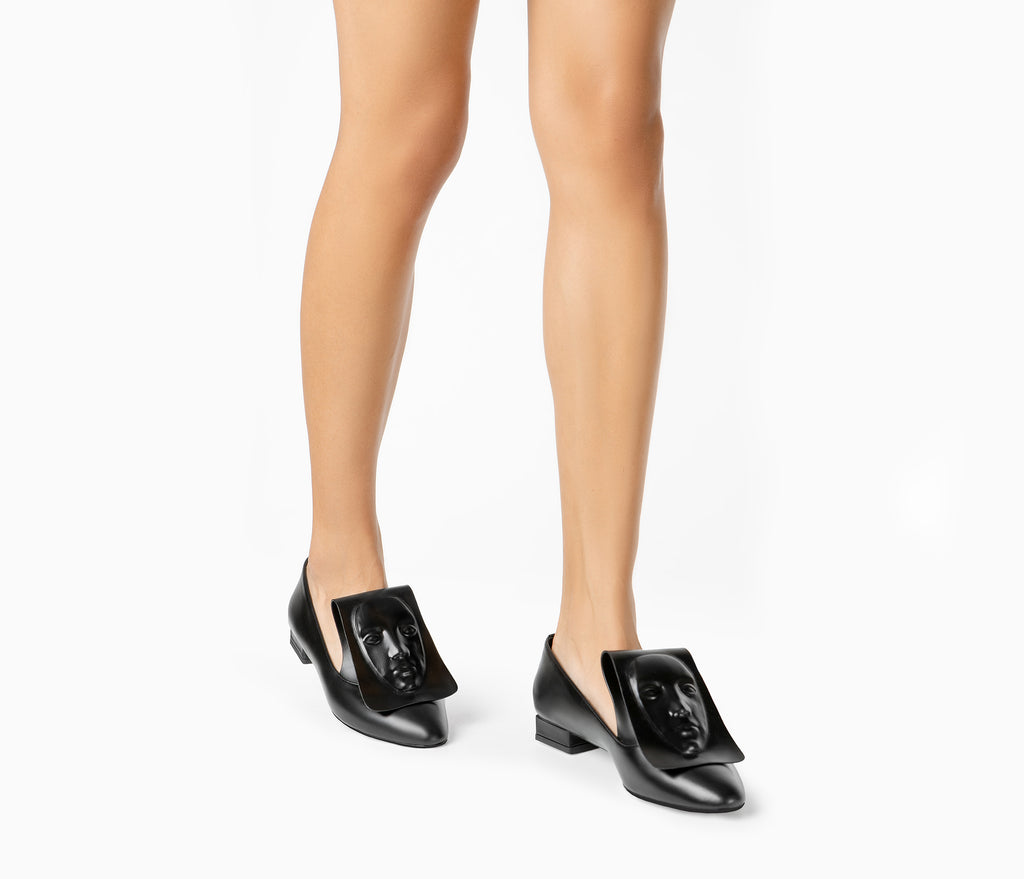 Artistic women's Clymene black loafers with a face