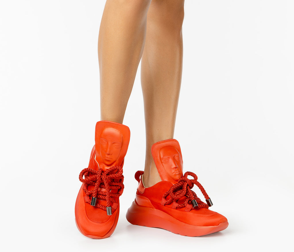 Stylish women's red sneakers from London
