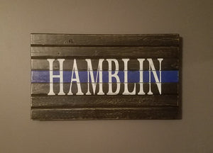 "Thin Blue Line Plaque, 10"" x 18""."
