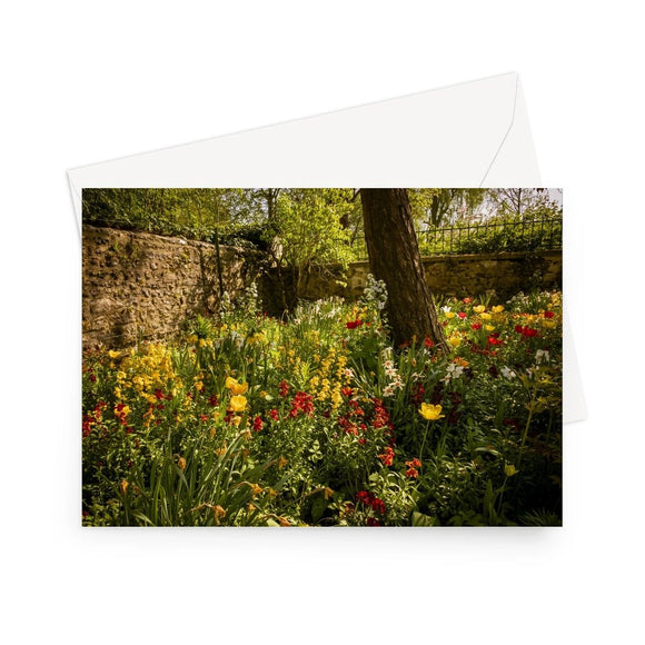 'Walled Garden at Giverny' - A colourful, shady corner in the walled area of Monet's garden at Giverny. In April, the garden is awash with countless varieties of tulip in every direction. High quality greeting card printed on heavyweight 330gsm Fedrigoni card. Supplied with envelope.