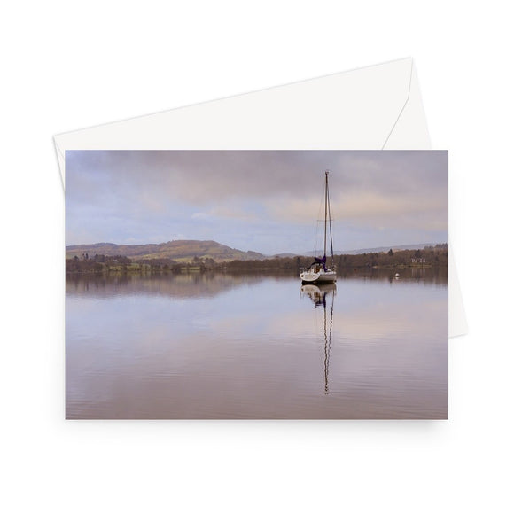 'Waiting for the Skipper' - High quality greeting card featuring my photograph of a lone sailboat at dawn on Grasmere in the Lake District. Printed on heavyweight 330gsm Fedrigoni card. Supplied with envelope.