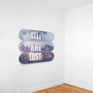 Not All Are Lost - 3 Piece Skateboard Wall Art mounted on a wall