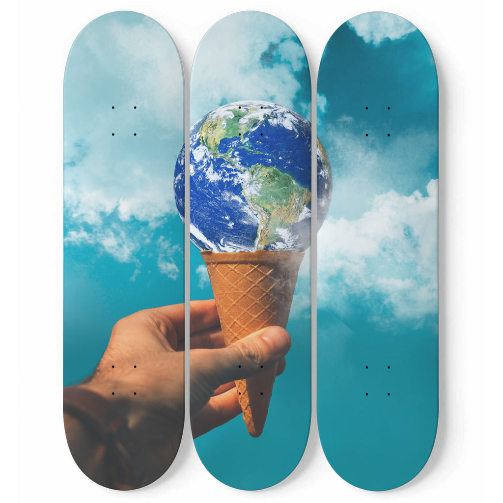 The World is Yours. The globe sitting on an ice cream cone in a hand - 3 Skateboard Wall Art