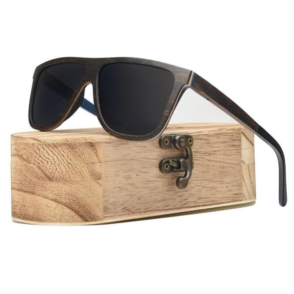 Skateboard Deck frame with polarized lenses. resting on a wooden box