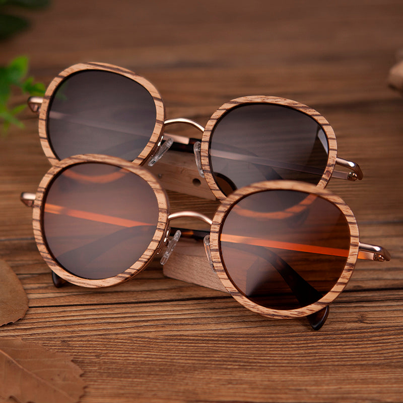 Pair of handmade wooden frame sunglasses with Steel frame