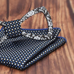 Floral Design Cutout Bow Tie Handkerchief Set in Navy Blue with white dots against a wood background