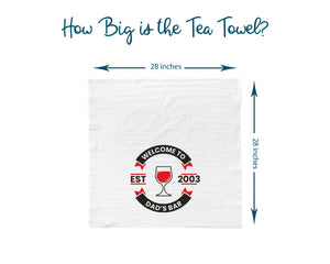 Information graphic showing the size of the bar towels. They are 28 inches by 28 inches square. The example towel shown has a red wine logo.