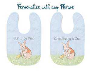 "The bib can be personalized with any phrase. Examples are ""Our Little Peep"" and ""Some Bunny is One"". Picture shows both phrase examples on East Bunny bib."