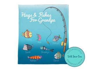 "Blue throw blanket with fishing rod and colourful fish. Each fish is personalized with grandchild's name and top of blanket reads ""Hugs and Fishes for Grandpa""."