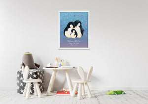 Child's playroom with table, chairs, toys and crayons. White framed picture of penguin family on wall.