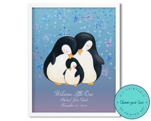 Framed picture of penguin family with purple and blue snowflake background.