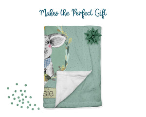 Makes the perfect gift. Green pig blanket folded with bow and confetti.