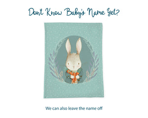 Information graphic showing that the name of the baby can be left off the blanket. A green vintage bunny blanket is shown without the ribbon or child's name.